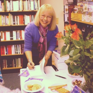 Sheila signing Mystical Circles at book launch in Kenilworth Books