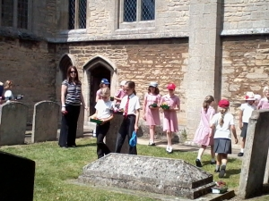 Local schoolchildren bring flowers to John Clare's grave in Helpston Churchyard (photo credit: Abigail Robinson)