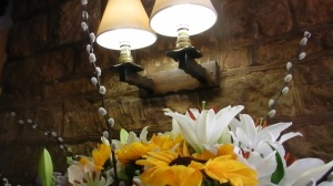 Lamp and flowers in Craig's farmhouse in Mystical Circles (photo credit Abigail Robinson)