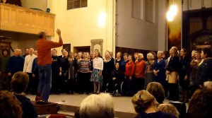 Bruce Knight conducting Songlines Community Choir in a performance of Nkosi Sikelelik 'lAfrika in St Mary's Church Leamington Spa on Saturday  7 December 2013