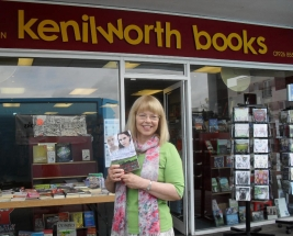Sheila Skillman with Mystical Circles outside Kenilworth Books