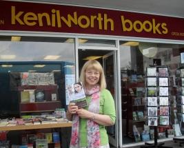 Sheila Skillman with Mystical Circles outside Kenilworth Books