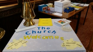 "Table display saying ""The Church Welcomes"" in St Mark's Church Leamington Spa"
