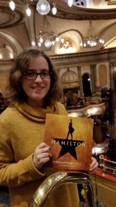 Abigail with Hamilton programme in auditorium of Victoria Palace Theatre