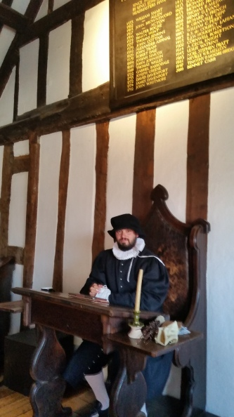 Actor playing the part of a 16th century schoolmaster in Shakespeare's Schoolroom