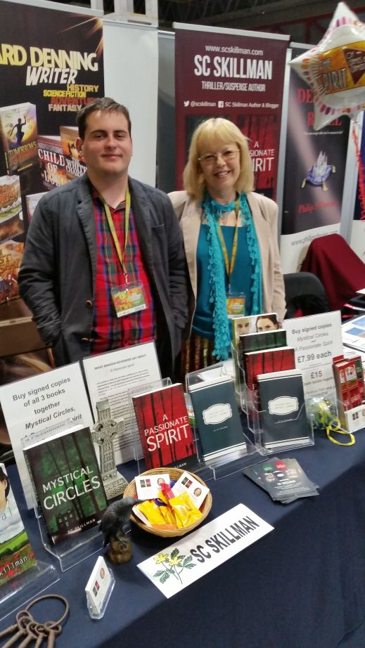 SC Skillman and assistant Jamie Robinson on the Author Stand at the UK Games Expo 2019