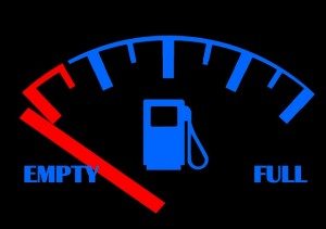 petrol gauge in car showing tank is empty