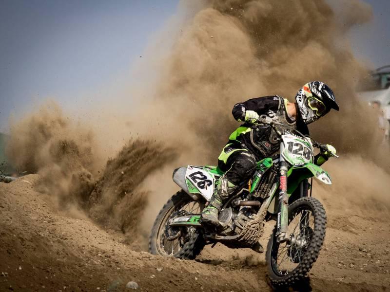 biker in leathers dust whirling behind him SC Skillman modern angels