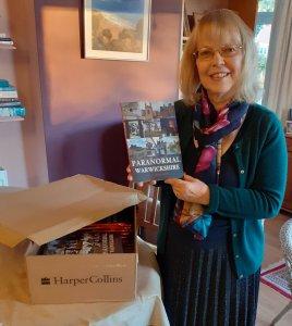 Author SC Skillman opening box of books Paranormal Warwickshire